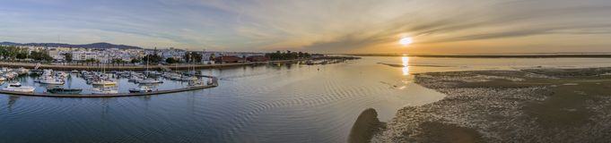 Sunrise aerial seascape view of Olhao Marina, waterfront to Ria Formosa natural park. Royalty Free Stock Photography