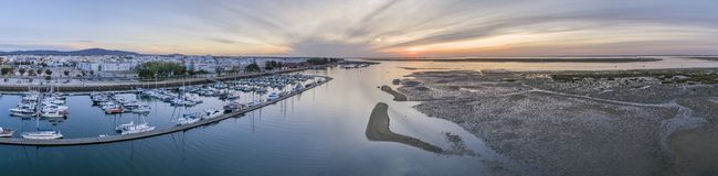 Sunrise aerial seascape view of Olhao Marina, waterfront to Ria Formosa natural park. Royalty Free Stock Photos