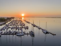 Sunrise aerial seascape view of Olhao Marina, waterfront to Ria Formosa natural park. Algarve. Portugal Royalty Free Stock Image
