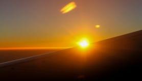 Sunrise from aeroplane Stock Photo