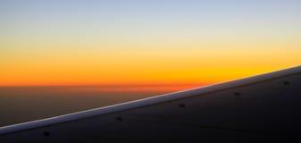 Sunrise from aeroplane Royalty Free Stock Image