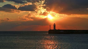 Sunrise against a beacon in Yalta stock video footage