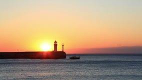 Sunrise against a beacon in Yalta, the Crimea stock footage