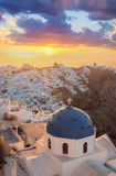 Sunrise against church on Santorini island in Greece Royalty Free Stock Photography