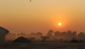 Sunrise at agriproduct processing establishment. Sunrise view from agricultural cassava root processing establishment Royalty Free Stock Photo
