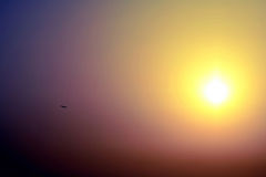Sunrise with airplane aircraft in contre-jour. Sunrise on a field with airplane jet plane in contre-jour royalty free stock image