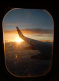 Sunrise in airplane window Royalty Free Stock Image