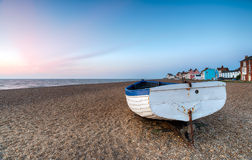 Sunrise at Aldeburgh. Fishing boat on the shingle beach at Aldeburgh on the Suffolk coast Royalty Free Stock Images