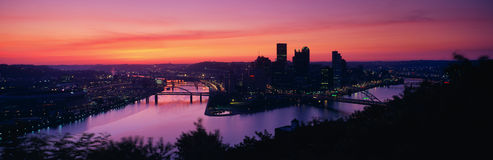 This is sunrise on the Allegheny and Monongahela Rivers where they meet the Ohio River. This is the view from Mount Washington. Royalty Free Stock Images