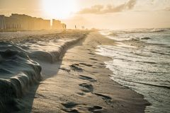 Sunrise along the Florida panhandle. Sunrise and surf along the Florida panhandle as the beach wakes up and gets ready for vacationers stock image