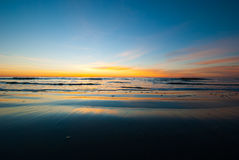 Sunrise along the Georgia Coast with Smooth Sand. Photogrpah of a sunrise before the sun crests the horizon of a Saint Simons Island Beach the sand having been Royalty Free Stock Images