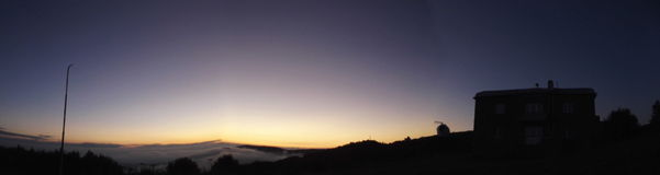 Sunrise in the alpine astronomical observatory. Widescreen Royalty Free Stock Image