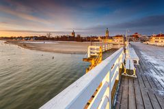 Cold morning at Pier in Sopot. Sunrise with amazing colorful sky. Winter in Poland. Cold morning at Pier in Sopot royalty free stock images