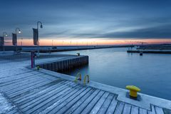 Cold morning at Pier in Sopot. Sunrise with amazing colorful sky. Winter in Poland. Cold morning at Pier in Sopot Stock Image
