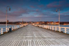 Cold morning at Pier in Sopot. Sunrise with amazing colorful sky. Winter in Poland. Cold morning at Pier in Sopot Royalty Free Stock Photo