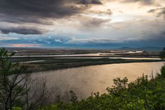Sunrise on the Amur River. Khabarovsk region in the far East of Russia. Early in the morning on the River Amur. Sunrise on the Amur River. Khabarovsk region in royalty free stock photo