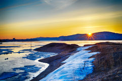 Sunrise on the Amur river in the spring. Royalty Free Stock Images