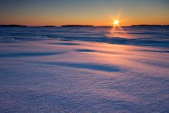 Sunrise And Snowy Beach Stock Images