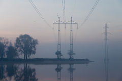 Sunrise And Transmission Lines Stock Photo