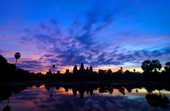 Sunrise at Angkor Wat in Siem Reap, Cambodia. Sunrise shot of Ankor Wat in Siem Reap, Cambodia where tourists gather early as 5 am to catch the sun's first rays stock photo