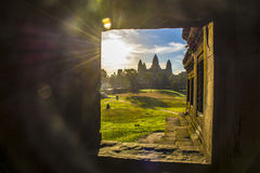 Sunrise of Angkor Wat,Siem Reap, Cambodia. Sunlight through ancient stone window ,View from Angkor Wat ruins near Siem Reap, Cambodia Stock Photos