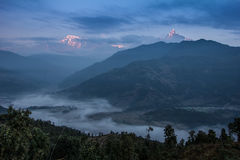 Sunrise in annapurna range (himalaya) from a small village Nepal - Asia Stock Image