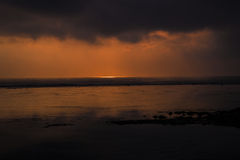 Sunrise and  Approaching storm Royalty Free Stock Image