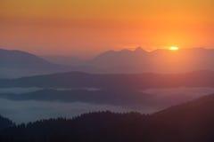 Sunrise on Aramaio valley. Sunrise on Aramaio foggy valley Royalty Free Stock Images