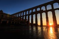 Sunrise between the arches of the Aqueduct of Segovia, Segovia. Spain Stock Image