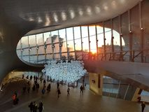 Sunrise in Arnhem central station. Sun comes in to the architectural building of Arnhem central station Stock Images