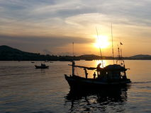 Sunrise. Ashoreboat silhouette sea Stock Photo