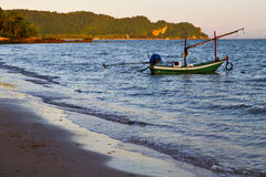 Sunrise asia the  lomprayah bay     rocks  boat   thailand   sea Stock Photography