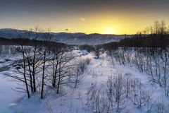 Free Sunrise At The River. Morning View Of Hakuba Miyama River. Snow Around Three Mountains Of Hakuba Nagano Prefecture, Japan. Feb 3, Royalty Free Stock Photo - 140267775