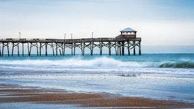 Sunrise at the Atlantic Beach Pier on Emerald Isle royalty free stock photos