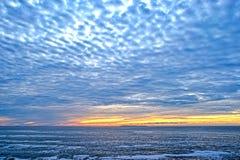 Sunrise on the Atlantic Ocean. A yellow sunrise on the Atlantic Ocean as seen from Pemaquid Point, Maine Stock Image