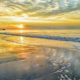 Sunrise Atlantic ocean beach morning sand shore ocean waves low tide sunlight. Sunrise at the beach Royalty Free Stock Photos