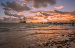 Sunrise on the Atlantic ocean. Beautiful morning landscape with caravel near wooden pier in Punta Cana. Dominican Republic Stock Photos
