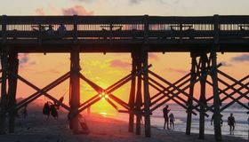 Sunrise on Atlantic Ocean at Folly Beach SC. Sun rising on the Atlantic Ocean at Folly Beach pier in South Carolina Royalty Free Stock Image