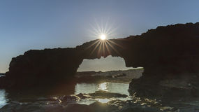 Sunrise atop the stone arch gate Ly Son Island Stock Photography