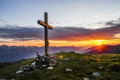 Sunrise in the Austrian Alps. The sun is rising over the summit of Hundskopf mountain, Tyrol, Austria, July 2018 stock photography