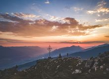 Sunrise in the Austrian Alps. The sun is rising over the summit of Largoz mountain, Tyrol, Austria, July 2018 royalty free stock image