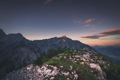 Sunrise in the Austrian Alps. The sun is rising over the summit of Hundskopf mountain, Tyrol, Austria, July 2018 royalty free stock photos