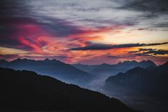 Sunrise in the Austrian Alps. The sun is rising over the summit of Hundskopf mountain, Tyrol, Austria, July 2018 royalty free stock photo