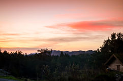 Sunrise in autumn landscape over mountains stock image