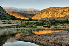 Sunrise on awesome river in mountains Stock Photos