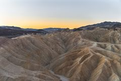 Sunrise on the badlands of Zabriskie Point, Death Valley National Park, California. Sunrise on the famous mudstone and claystone of Zabriskie Point, Death Valley Stock Images