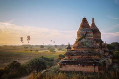 Sunrise at Bagan  Myanmar, pagodas and balloons scene Royalty Free Stock Images