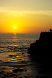 Sunrise on Bali island. This is a beautiful sunrise on the Indian sea with shadows on a Balinese temple stock photo