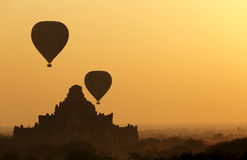 Sunrise balloons over Bagan. Royalty Free Stock Photos