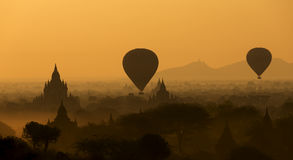 Sunrise balloons over Bagan. Stock Photos